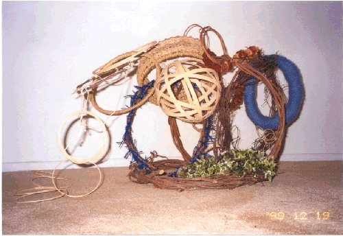 scuplture with basket materials and found objects